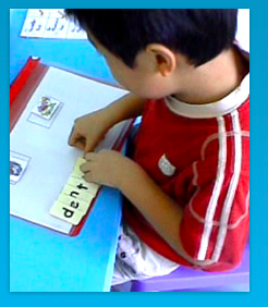 A young boy learning how to spell